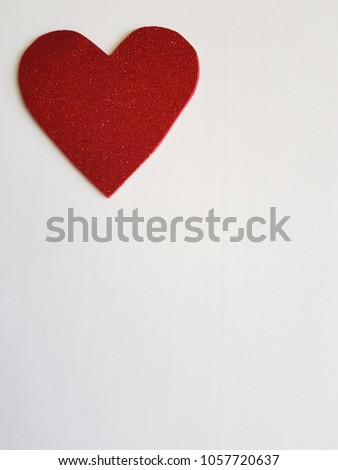 bright red heart in the corner, on a white background #1057720637