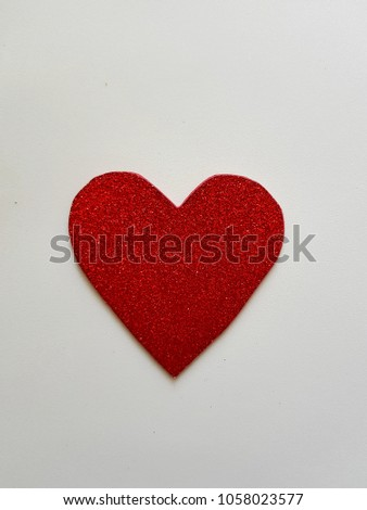 bright red heart on a white background #1058023577