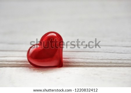 bright red heart on a wooden surface #1220832412