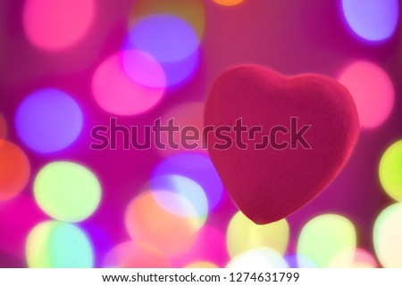Bright red heart on blurred background, festive background or postcard for Valentine's day with copy space #1274631799