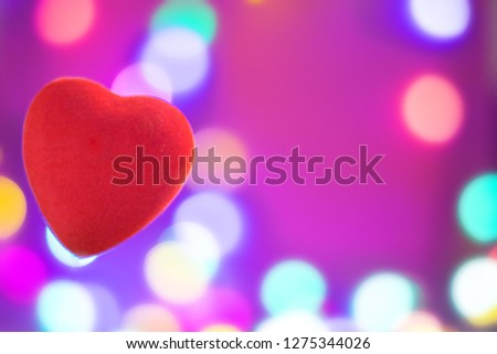 Bright red heart on blurred background, festive background or postcard for Valentine's day with copy space #1275344026