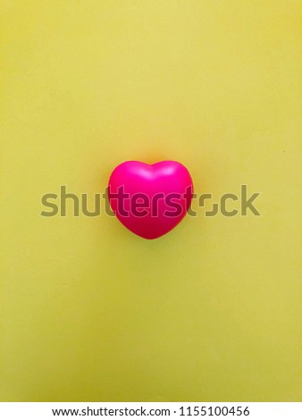 Bright red heart on vibrant yellow background with copy space #1155100456
