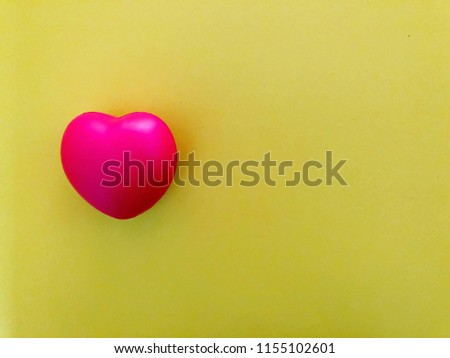 Bright red heart on vivid yellow background with copy space #1155102601