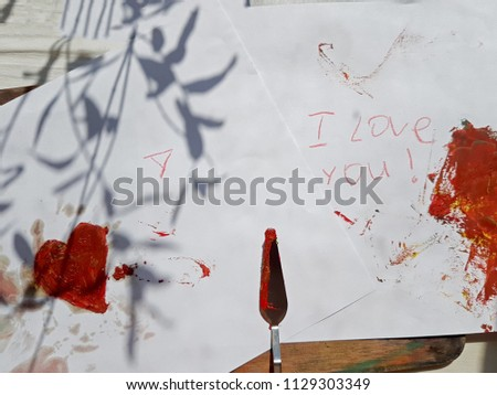 Bright red heart painted with paint, palette knife. With the inscriptions I Love you. Art work drawing on the topic of Love, family. #1129303349
