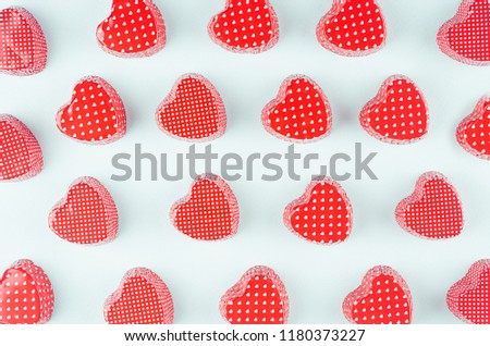 Bright red hearts on mint pastel paper background. Valentine's day youth design concept art.  #1180373227