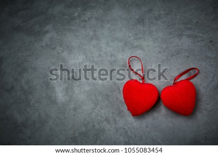 bright red hearts on the dark gray concrete background #1055083454