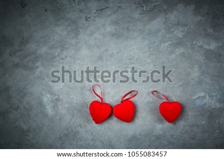 bright red hearts on the dark gray concrete background #1055083457
