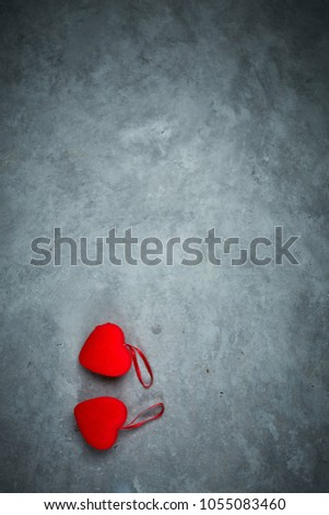 bright red hearts on the dark gray concrete background #1055083460