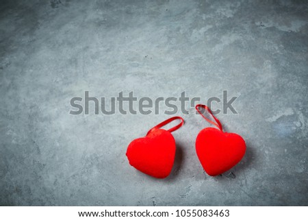 bright red hearts on the dark gray concrete background #1055083463