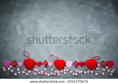 bright red hearts on the dark gray concrete background #1056370676