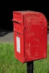 Bright red iconic British post box