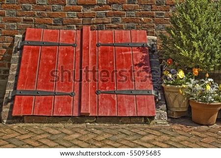 Bright Red Old Cellar Doors and Brick Wall