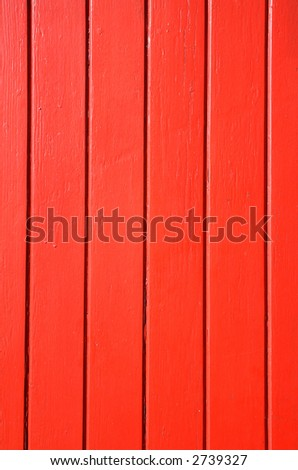 Bright red painted door wood background.