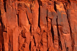 Bright red rock cliff in the rugged back-country of Utah