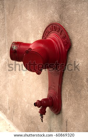Bright red standpipe on a downtown Chicago wall