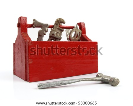 Bright red tool box full of little toy tools