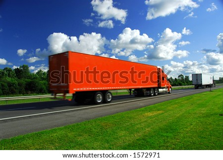 Bright red truck on road, blurred because of fast motion