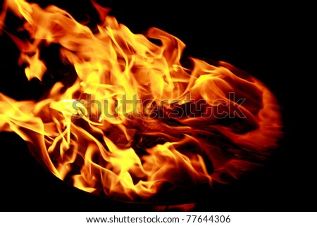 Bright red yellow fire flames on black background