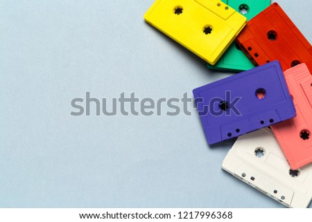 Bright retro cassette tapes on a light grey background