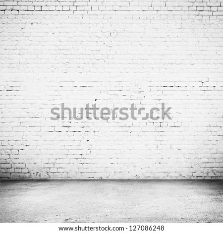 Bright room with tile floor and brick white wall background