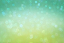 Bright saturated sparkling green-light bokeh close-up for your design