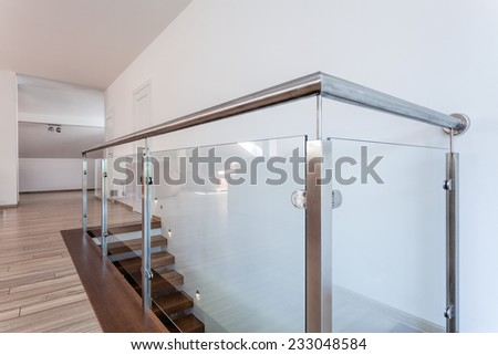 Bright space - a closeup of a silver glass barrier