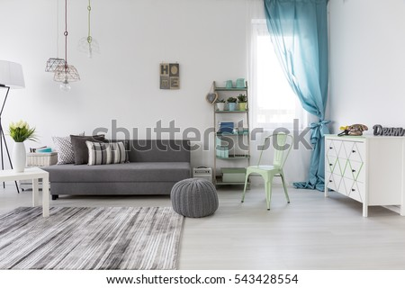 Bright spacious living room with comfortable couch and chest of drawers #543428554