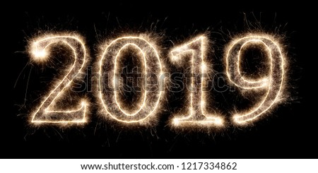 bright sparkler pyrotechnic fireworks number 2019 happy new year sylvester concept isolated on black background #1217334862