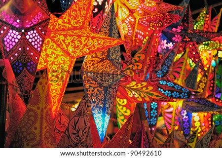 Bright stars. Folding paper lanterns from India