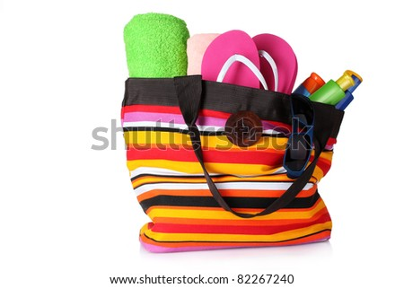 bright striped beach bag isolated on white