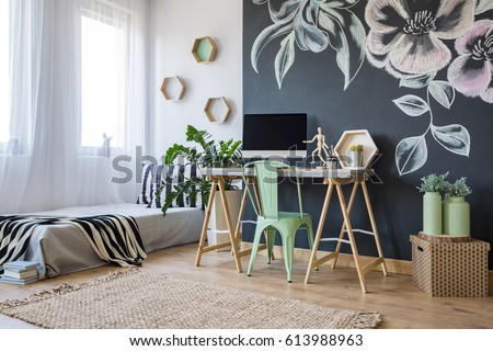 Bright studio apartment with creative blackboard wall decoration