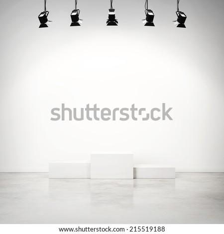 Bright studio interior with empty white podium #215519188
