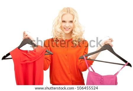 bright studio picture of beautiful teenage girl with clothes - stock photo
