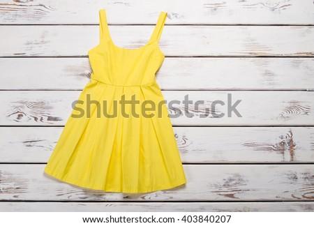 Bright summer dress. Trendy yellow sarafan.