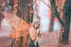 bright summer photo with shining rays of sun, mysterious forest fairy fell in love with prince, girl with puppet face, blond long hair and blue eyes, lady in green dress peeps modestly, with interest.