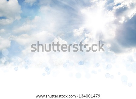 Bright sun in clouds. Copy space