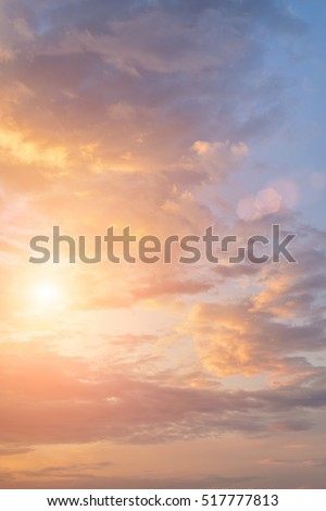 bright sun in cloudy sky at...