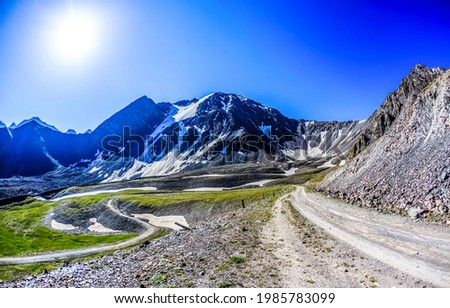 Bright sun in the mountains. Road in mountains. Mountain sun road landscape