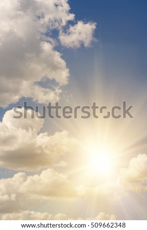 Bright sun on blue sky with white fluffy clouds, background #509662348