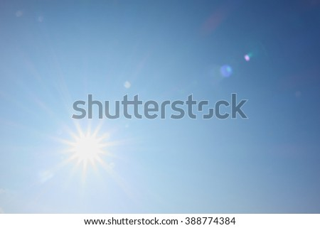 bright sun shines like a star with rays #388774384