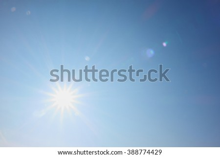 bright sun shines like a star with rays #388774429