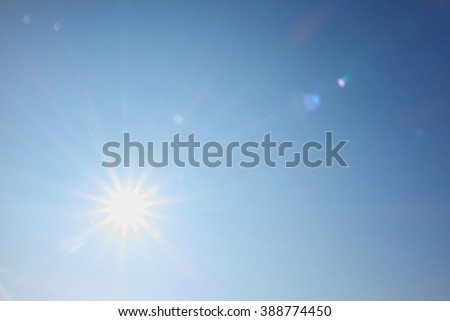 bright sun shines like a star with rays #388774450