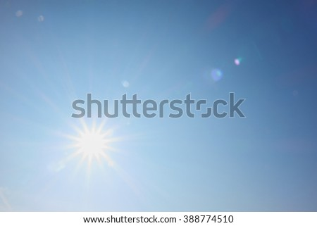 bright sun shines like a star with rays #388774510