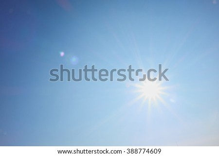 bright sun shines like a star with rays #388774609