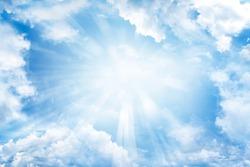 Bright sun shining in clouds
