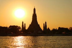 Bright Sun Shining over the Silhouette of Wat Arun or the Temple of Dawn, Historic Place in Bangkok Old City, Thailand