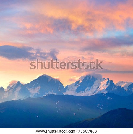 Bright sundown on mountain array. Composition of the nature