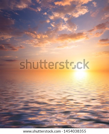 Bright sunlight at sunset and cirrus clouds above the sea. Natural Dawn Composition #1454038355