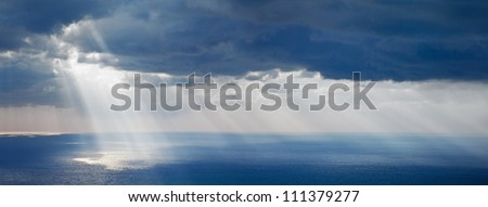 Bright sunlight over ocean, beautiful shine sun beam in sky, abstract blue natural background, peaceful skyscape, open heaven and God, morning sun rays, Mediterranean resort, panoramic sea - stock photo