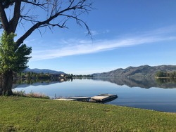 Bright sunny summer day at Osoyoos Lake with private dock